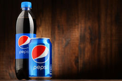 Bottle and can of carbonated soft drink Pepsi Stock Images