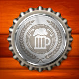 Bottle cap with beer mug & wreath Royalty Free Stock Photos