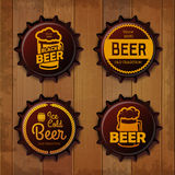 Bottle cap Design. Beer labels. Wooden texture Royalty Free Stock Photos