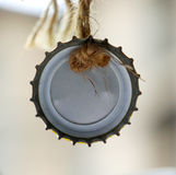 Bottle Cap hanged on a rope Stock Images