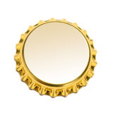 Bottle cap isolated. Gold bottle cap isolated on white Royalty Free Stock Photos