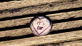 A bottle cap in a piece of wood. It`s OK royalty free stock photography