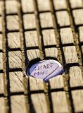 A bottle cap in a piece of wood. Share More stock photo