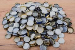 Bottle cap piled on wooden board in flat lay style royalty free stock image