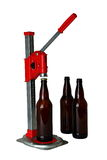 Bottle Cap Press and Bottles for Homebrew Beer. A benchtop bottle capper used for bottling homebrew beer Stock Photography