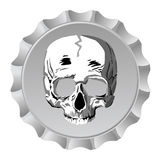 Bottle cap with skull Royalty Free Stock Photography