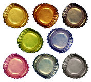 Bottle Caps 1. A set of eight various colored crushed bottle caps royalty free stock photos