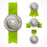 Bottle caps with beer mug & ribbon. Metallic bottle caps with beer mug & ribbon on white,  illustration Stock Images