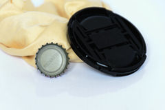 Bottle caps , black cover and rags isolated Stock Photography