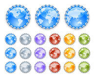 Bottle caps with earth globes Royalty Free Stock Photos