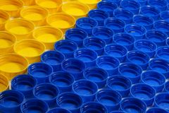 Bottle caps made of HDPE high-density polyethylene segregated according to the colors prepared for recycling stock photo
