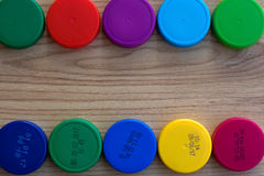 Bottle caps with and without the production date. Plastic caps from PET bottles, Expiration date on the PET packaging Date of production, Expiration date Food stock photo