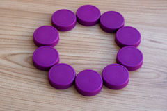 Bottle caps - purple circle, Background, copy space royalty free stock photography
