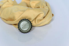 Bottle caps and rags isolated Stock Images