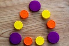Bottle caps - triangle of multicolored PET plastic caps stock image