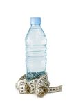 Bottle and centimeter Royalty Free Stock Image