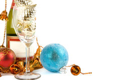 The bottle of champagne. And christmas decorations on the white background Royalty Free Stock Photography