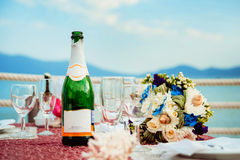 A bottle of champagne. Beautiful glasses Stock Photos