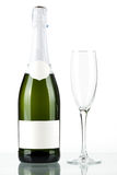 Bottle of champagne with blank label and glass Royalty Free Stock Photography