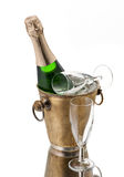 Bottle of champagne in bucket and glasses Stock Photography