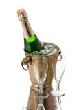 Bottle of champagne in bucket and goblets isolated on white. Bottle of champagne in a bucket with ice and glasses Royalty Free Stock Photo