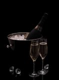 Bottle of champagne in bucket isolated with deco diamonds Royalty Free Stock Photo