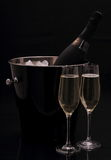 Bottle of champagne in bucket, two glasses Royalty Free Stock Photography
