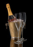 Bottle champagne in bucket and two glasses, Stock Photography