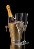 Bottle champagne in a bucket and two glasses. Bottle of champagne in a bucket and two glasses, vertical Stock Photo