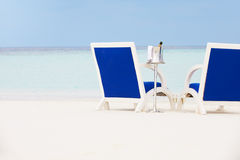 Bottle Of Champagne Between Chairs On Beautiful Beach Stock Photo