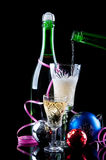Bottle of champagne and christmas balls Royalty Free Stock Image