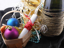 Bottle of champagne, christmas balls and white invitation paper Royalty Free Stock Photos