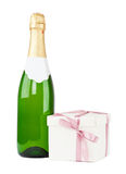 Bottle of champagne with Christmas present box Stock Photography