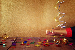 Bottle of champagne and colorful confetti Stock Photography