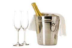 Bottle of Champagne in cooler with two glasses. Isolated on white Royalty Free Stock Images
