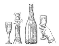 Bottle of Champagne explosion and hand hold glass. Stock Images