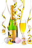 Bottle of champagne and filled goblet with festive gold ribbons Royalty Free Stock Image
