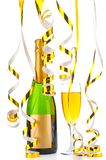 Bottle of champagne and filled goblet with festive gold ribbons Stock Images