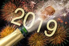 Bottle of champagne with flying cork and firework at Silvester 2019 stock image