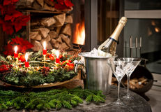 Bottle of champagne, glasses and fireplace Royalty Free Stock Photo