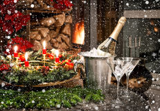 Bottle of champagne, glasses and fireplace Stock Image