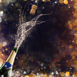 Bottle of champagne with glasses over fireworks background Royalty Free Stock Image