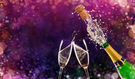 Bottle of champagne with glasses over fireworks background Royalty Free Stock Photography