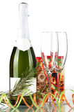 Bottle of champagne, glasses and small gift Royalty Free Stock Photo