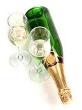Bottle of champagne and goblets Stock Images