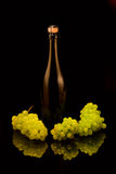 A bottle of champagne and grapes Royalty Free Stock Photo