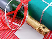 Bottle of a champagne and green gift boxes Royalty Free Stock Image