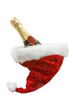Bottle of champagne in the hat of Santa Royalty Free Stock Photo