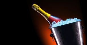 Bottle of champagne in ice bucket Royalty Free Stock Images