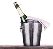 Bottle of champagne in ice bucket Stock Images